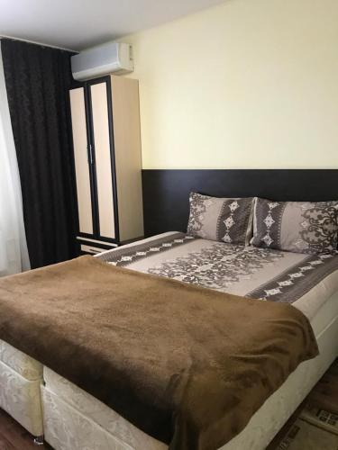 Кровать или кровати в номере Апарт-отель Yuzhniy