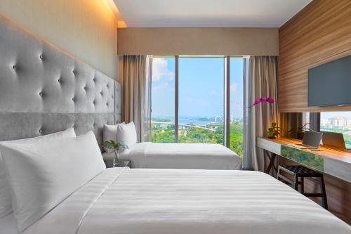 A bed or beds in a room at Pan Pacific Serviced Suites Beach Road (SG Clean, Staycation Approved)