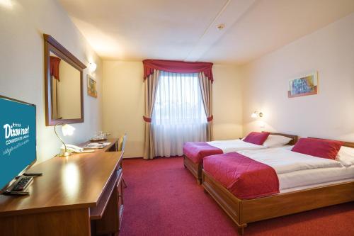 Posteľ alebo postele v izbe v ubytovaní Hotel Dixon