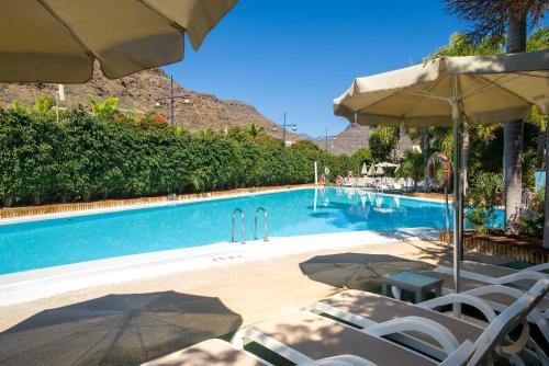 Het zwembad bij of vlak bij Apartamentos Cordial Mogán Valle