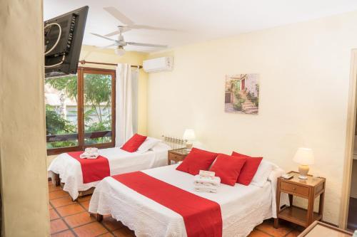 Cama o camas de una habitación en Posada El Viajero