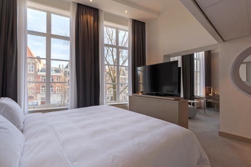 Télévision ou salle de divertissement dans l'établissement Radisson Blu Hotel, Amsterdam City Center