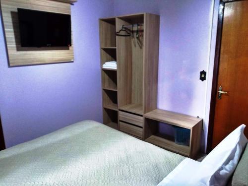A bed or beds in a room at Pousada Santo Antônio