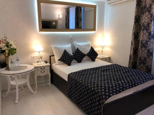 Кровать или кровати в номере Hotel Art Resort Boutique