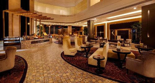 A restaurant or other place to eat at Grand Chennai by GRT Hotels