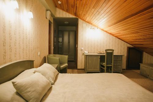 Кровать или кровати в номере Отель Шале