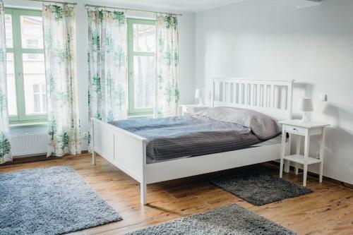 A bed or beds in a room at Villa Sopocka