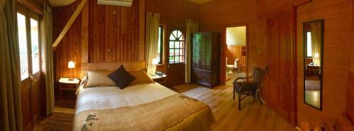 A bed or beds in a room at Chalet de Montaña-Espacio y Tiempo