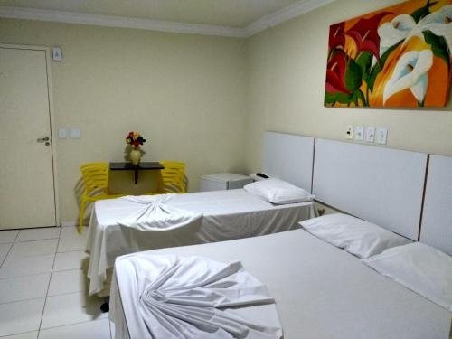 A bed or beds in a room at Hotel Monte Rei