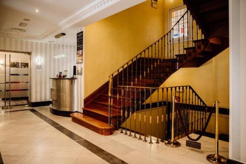 El vestíbulo o zona de recepción de Hotel Infantas by MIJ
