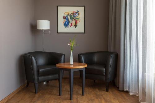 A seating area at Hotel Park Consul Köln
