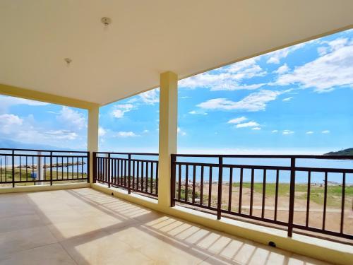 A balcony or terrace at Breezy Beachfront Villa