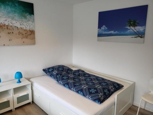 A bed or beds in a room at Ferienwohnung Central