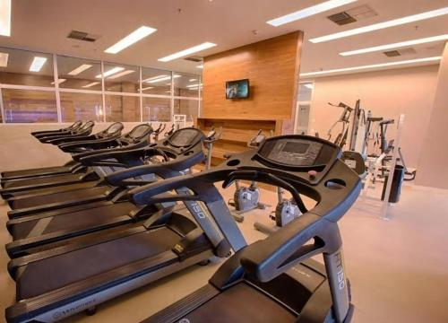 The fitness centre and/or fitness facilities at FLAT design moderno no Fusion Apart Hotel