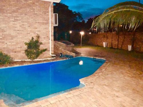 The swimming pool at or near GREEN TREE B&B