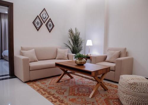 Uma área de estar em Malfakum Apartment Hotel