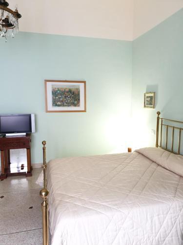 A bed or beds in a room at FraiFiori locazione breve