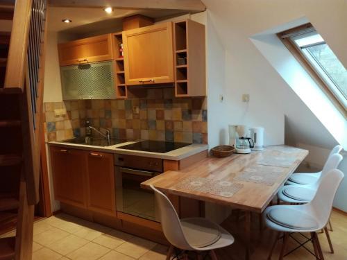 A kitchen or kitchenette at Apartments Dvor
