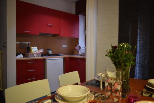 A kitchen or kitchenette at Portarotese apartment with terrace