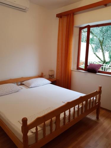 A bed or beds in a room at Accommodation Drasko