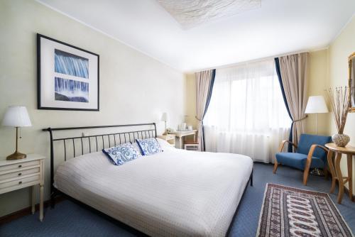 Кровать или кровати в номере St. Peter's Boutique Hotel