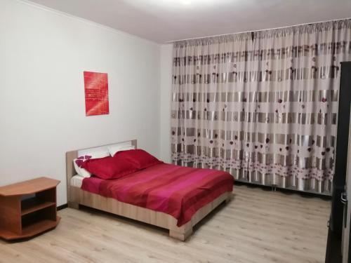 Кровать или кровати в номере Apartaments na Yablonevoy 7