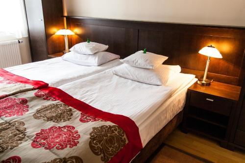 Łóżko lub łóżka w pokoju w obiekcie Willa Jolanta