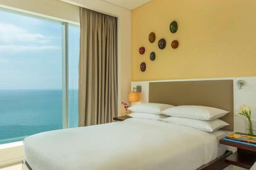 Een bed of bedden in een kamer bij Hyatt Regency Cartagena