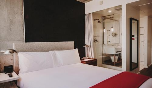 A bed or beds in a room at Nolitan Hotel SoHo - New York
