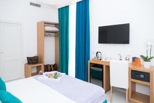TV o dispositivi per l'intrattenimento presso Sorrento Stylish Rooms