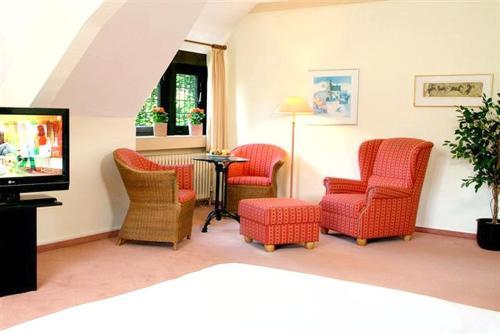 A seating area at Hotel Restaurant Hof Hueck