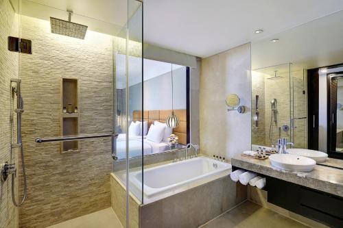 A bathroom at Pullman Bali Legian Beach