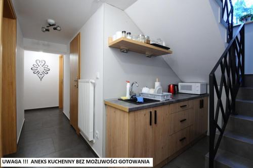 A kitchen or kitchenette at Willa Centrum