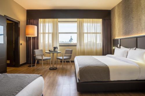 Cama o camas de una habitación en HF Fenix Lisboa