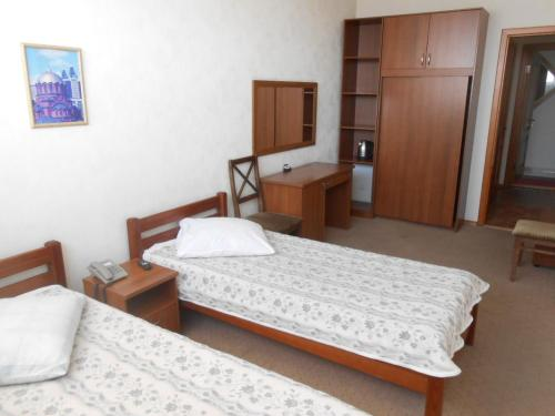 Кровать или кровати в номере Набережная