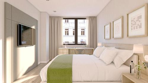 A bed or beds in a room at Aparthotel Attica 21 Vallés