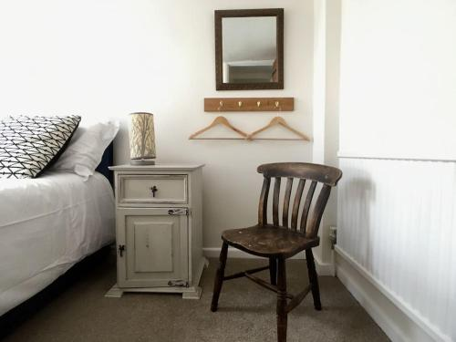 A seating area at MyCityHaven - The Siston Cottage