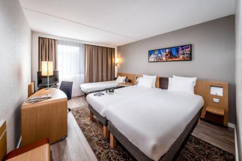 Ein Bett oder Betten in einem Zimmer der Unterkunft Novotel Breda