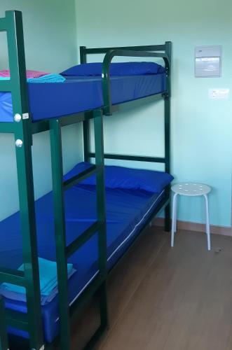Litera o literas de una habitación en Albergue la escuela