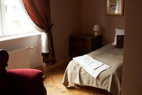 Łóżko lub łóżka w pokoju w obiekcie Belle Epoque