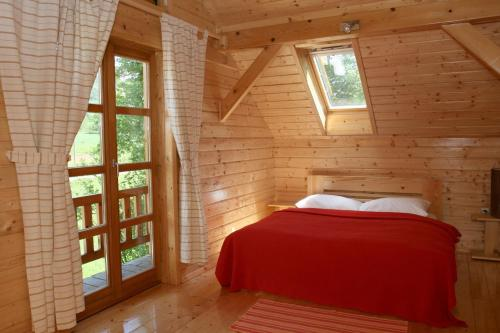 A bed or beds in a room at Ranch Jelov Klanac