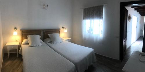 A bed or beds in a room at Casa Rural Macrina