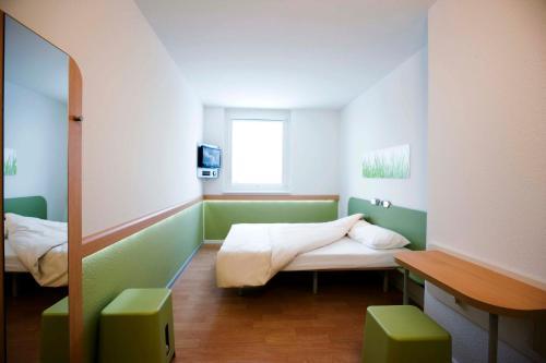 Кровать или кровати в номере Ibis budget Wien Messe