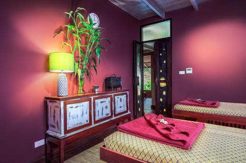 A bed or beds in a room at Sriwilai Sukhothai