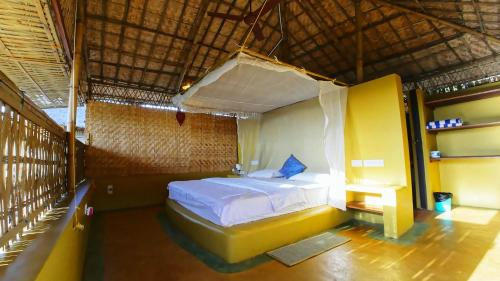 A bed or beds in a room at Beach Street Eco Resort & Spa