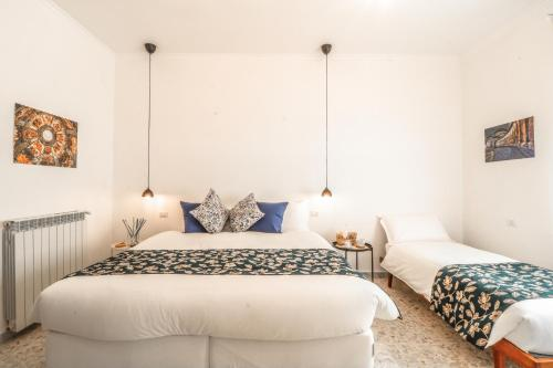 A bed or beds in a room at Le stanze di Virgilio