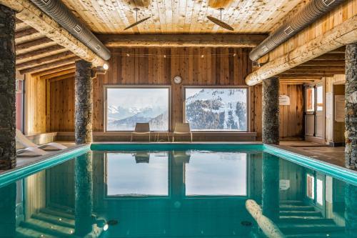 The swimming pool at or near Résidence Pierre & Vacances Premium Les Hauts Bois