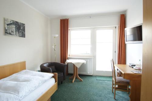 Ein Bett oder Betten in einem Zimmer der Unterkunft Margarethenhof