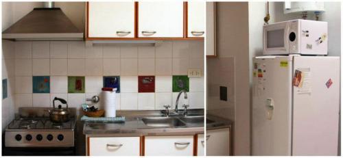 A kitchen or kitchenette at Apart Hotel Abedules