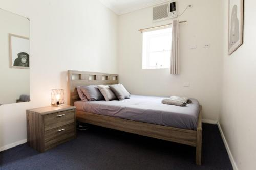 A bed or beds in a room at Mad Monkey Backpackers on Broadway